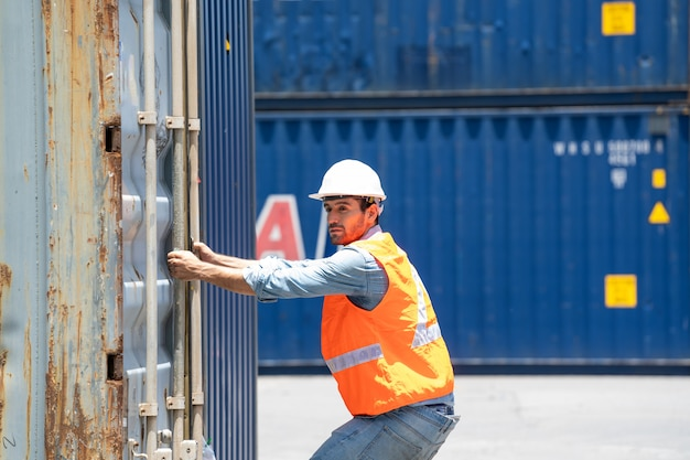Foreman worker working at container warehouse,shipping transportation concept.