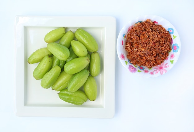 Forest fruit flavor fatigue has named ta-ling ping in white square plate serve with chili