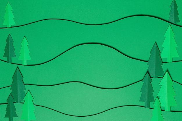 切り絵風の森の木々の風景。ペーパークラフトの背景