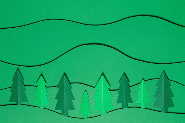 Forest trees landscape in paper cutting style. paper craft background