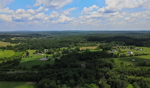 Forests and farm fields in the mountains pocono of pennsylvania landscape panoramic view of beautiful the blue sky