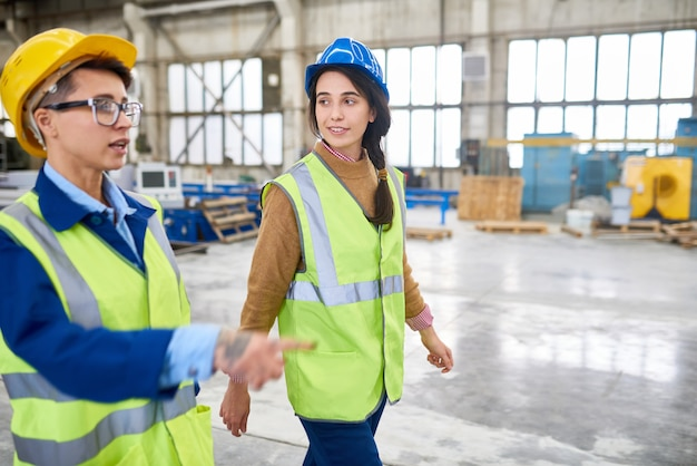 Forewoman showing construction site to new employee