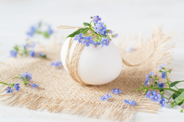 Forget me not flowers and easter egg. holidays decoration.