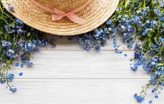 Forget-me-not flowers and straw hat