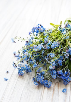 Forget-me-not flowers  on white  wooden background