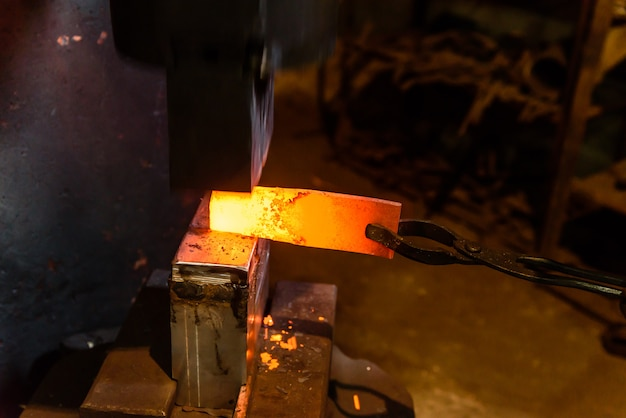 Forging molten metal. making knives.