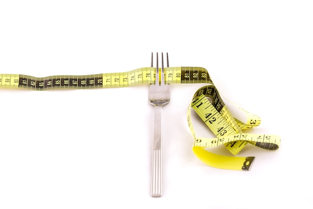 Fork and centimeter tape, slimming concept