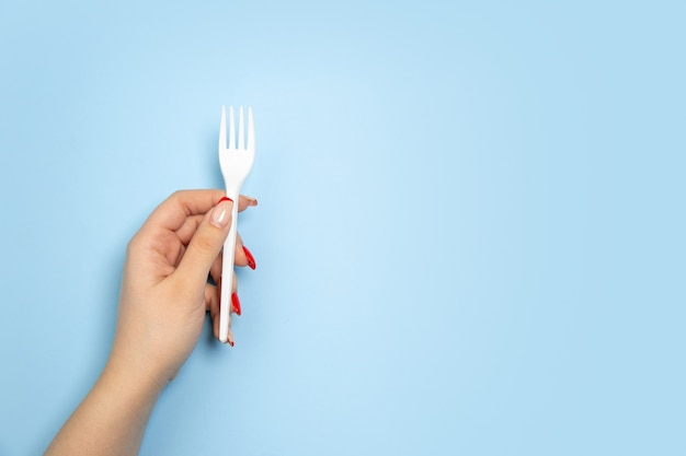 Fork. eco-friendly life - polymers, plastics things that can be replaced by organic analogues. home style, choose natural products for recycle and not harmful to the environment and health.