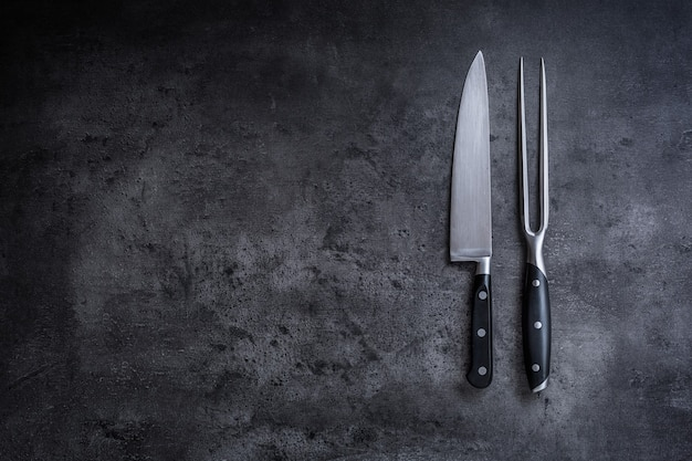 Fork and knife. fork and knife on concrete board.
