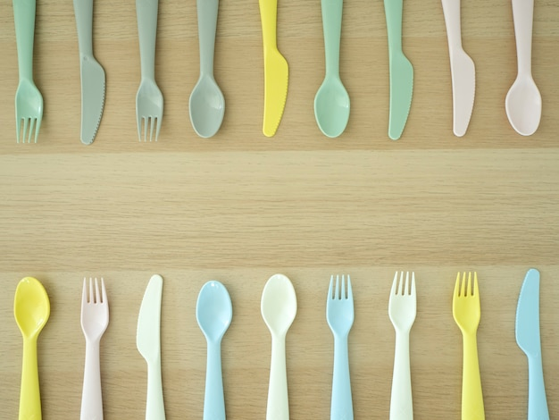 Fork knife spoon colorful on wooden