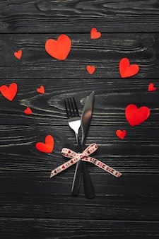Fork and knife on table with hearts