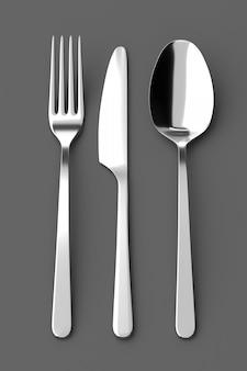 회색 배경에 포크, 스푼 및 나이프