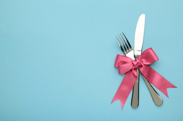 Fork and spoon with red ribbon