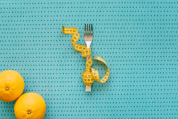 Fork, tape measure and oranges