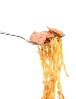 Fork with ham chili paste spaghetti on white background
