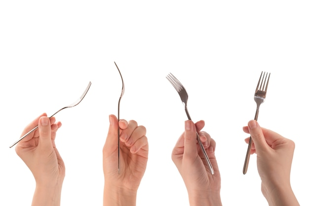 Fork in woman hand isolated on white background.