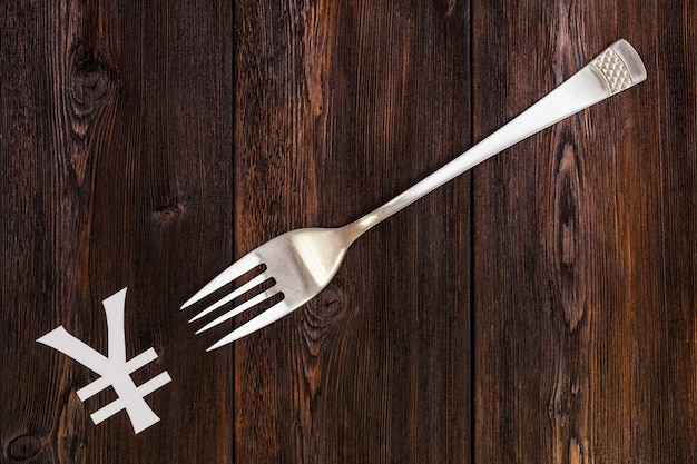 Fork and yen sign. abstract conceptual image