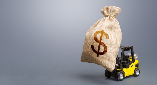 Forklift carrying a dollar money bag. anti-crisis budget. strongest financial assistance