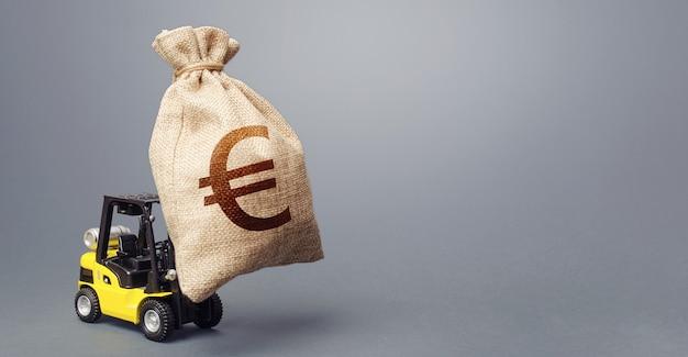 A forklift carrying a huge euro money bag