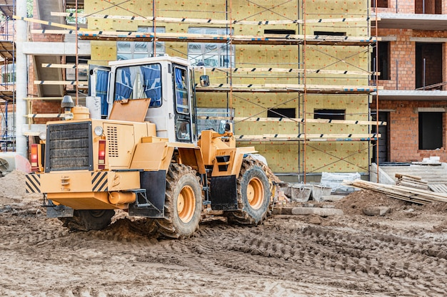 A forklift at a construction site is lifting a reinforced concrete slab. construction machine. industry.