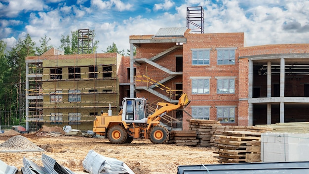 A forklift at a construction site is lifting a reinforced concrete slab. construction machine.