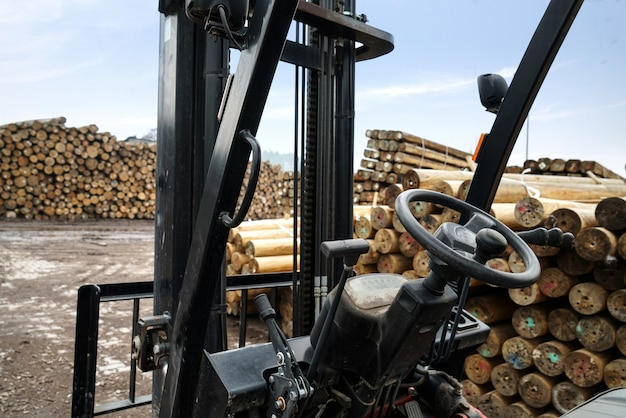 A forklift is parked in a timber factory