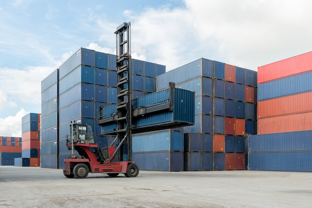 Forklift lifting container box loading to container depot use for cargo import, export, logistics