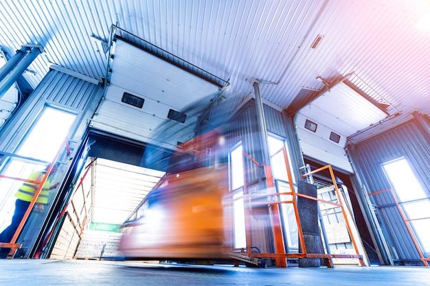 Forklift loader working at beverages plant warehouse