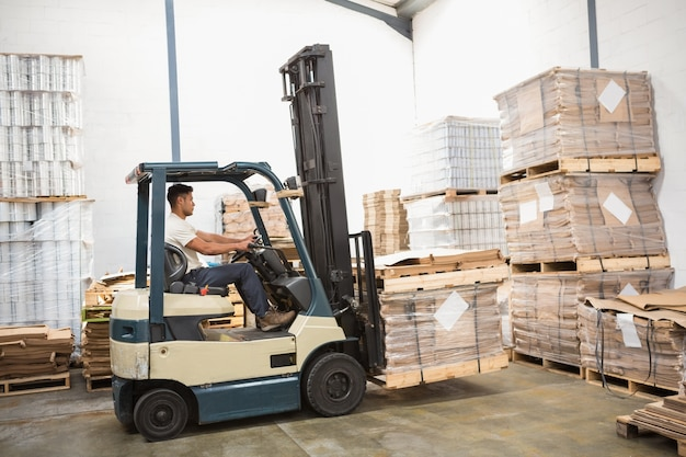 Forklift machine in a large warehouse