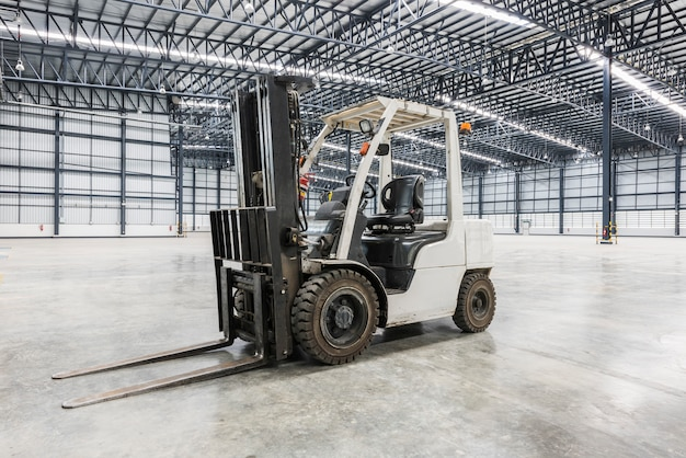 Forklift in a modern warehouse at factory