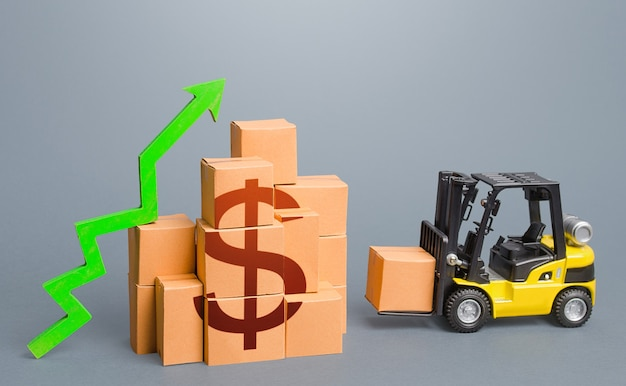 Forklift near a stack of dollar boxes with a green up arrow sales growth concept production