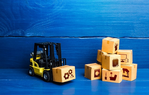 Forklift truck and cardboard boxes with goods logistic infrastructure and warehousing services