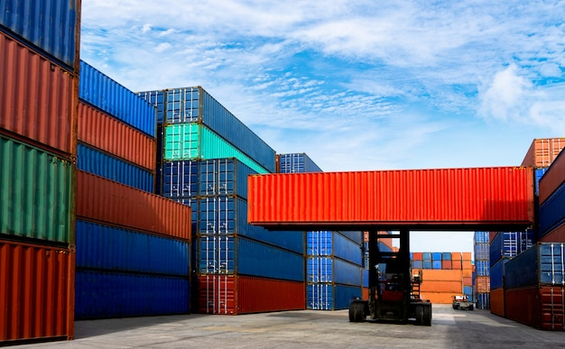 Forklift truck handling container box in shipping industry