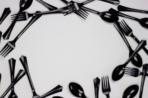Forks and spoons on a white background. minimal concept. without plastic.