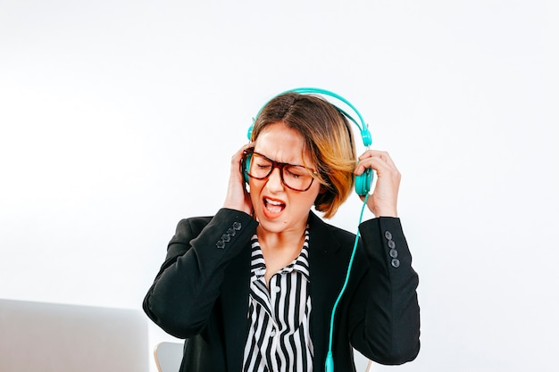 Formal woman suffering from loud noise