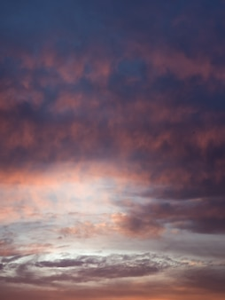 Formation of a cyclone in the sky. colorful cloudy sky at sunset. sky texture, abstract nature background
