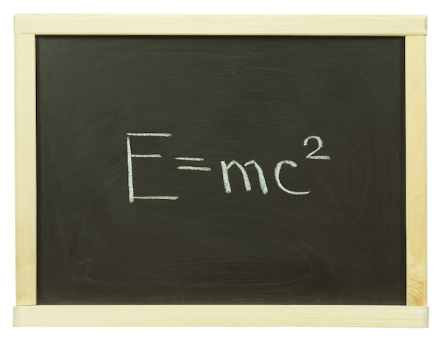 Formula written on a blackboard with white chalk