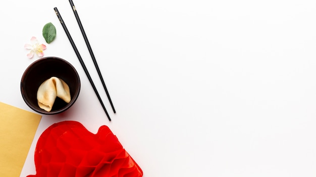 Fortune cookie and chopsticks new chinese year