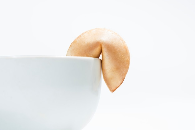 Fortune cookies on edge of the bowl for dessert dish