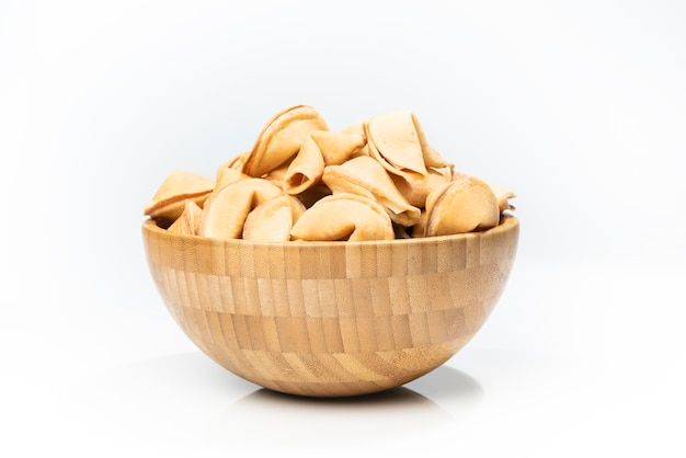 Fortune cookies in the wooden bowl