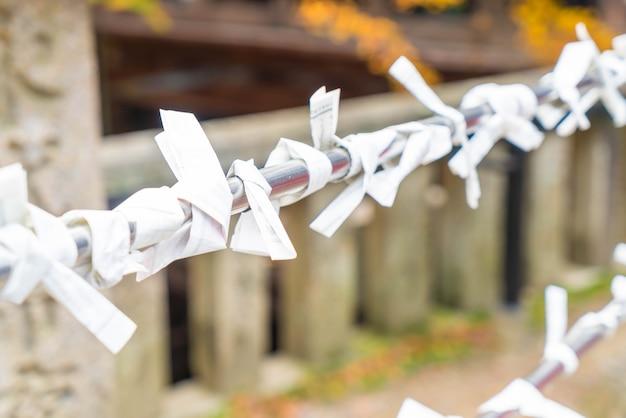 Fortune teller paper strip in temple