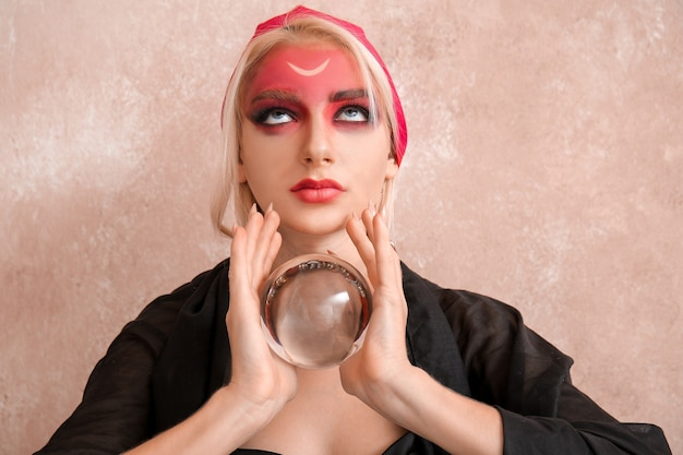 Fortune teller with crystal ball on color