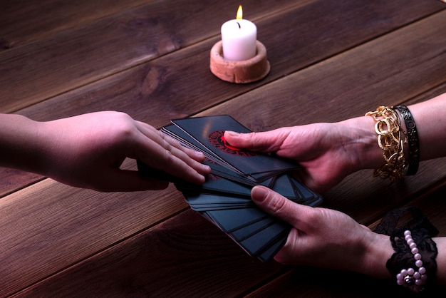 Fortune telling cards, runic cards for divination on a wooden table. fortune-telling accessories. top view