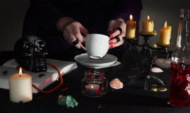 Fortune-telling on coffee grounds, fortune teller's hands and attributes for witchcraft