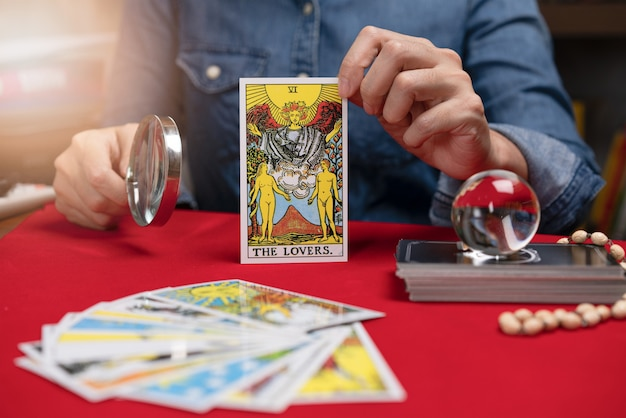 Fortuneteller holding tarot fortune the lovers card of one of the most popular