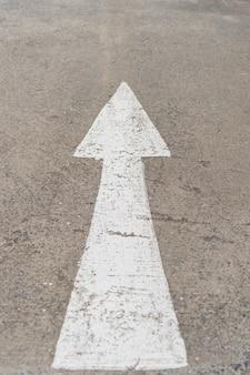 Forward arrow sign on road