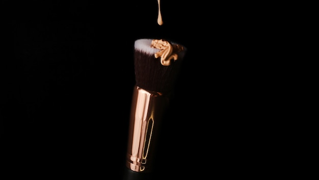 Foundation beauty facial cosmetics dripping bb cream or concealer over pink background