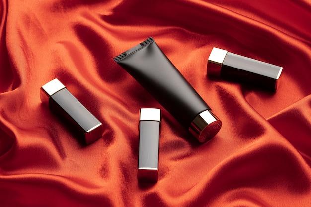 Foundation and lipsticks arrangement