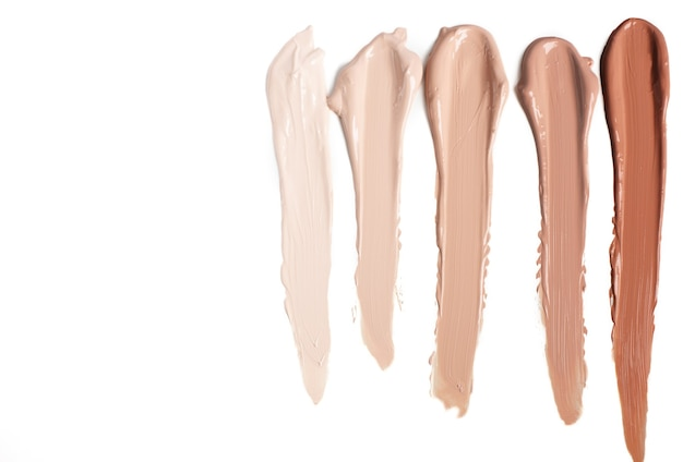 Foundation swatches of different shades on a white background. space for text