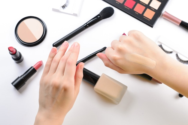 Foundation in woman hands